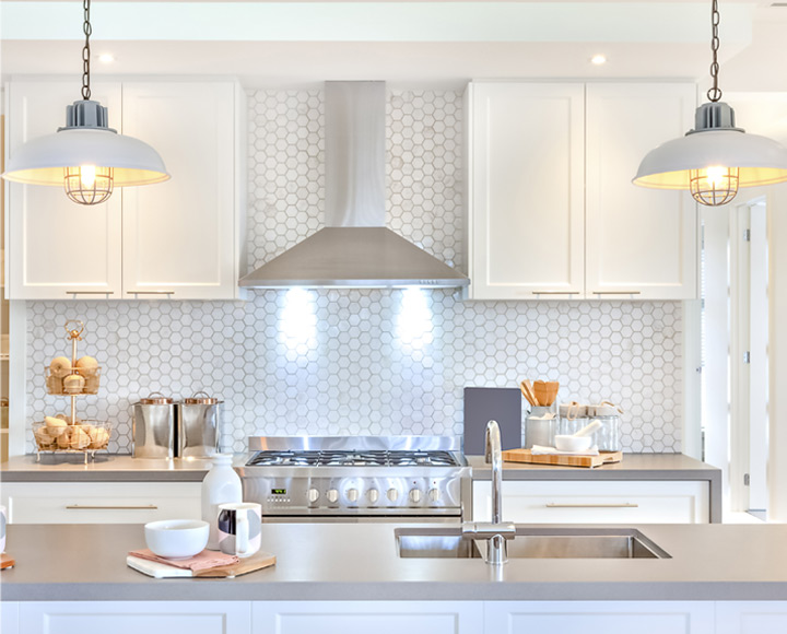 Modern kitchen with white honeycomb tile in property from professional edmonton realtor Alison Murray