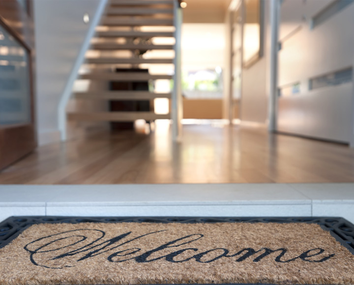 Floor level image of welcome mat and stairs, this is how to sell your Edmonton condo or home